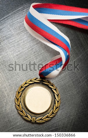 Blank medal on steel scratchy background - stock photo
