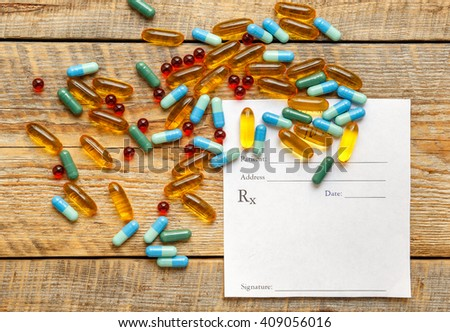 blank medical prescription and pills on wooden table isolated - stock photo