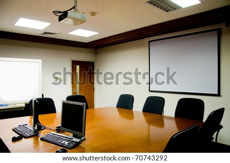 Blank meeting room with projector