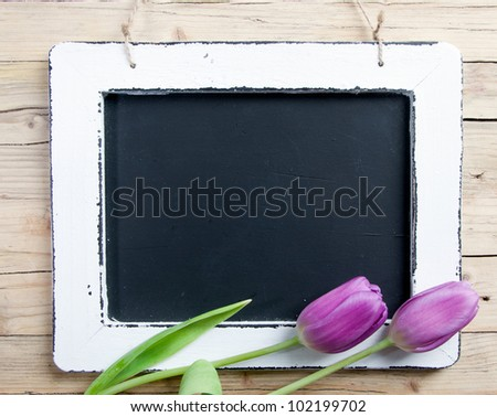 Blank Message board with lilac flower and copy space. - stock photo