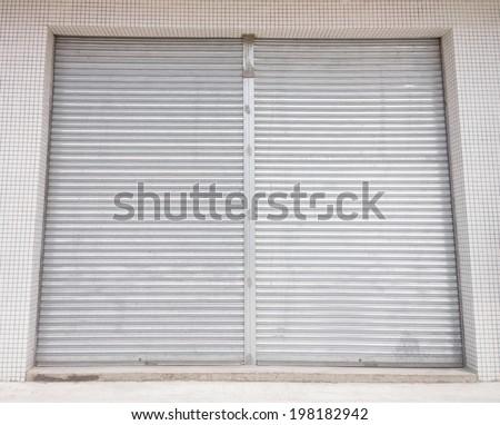 blank metal shutter doors on commercial shop front
