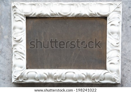 Blank metal sign on the wall with stucco frame outdoors and copy space - stock photo