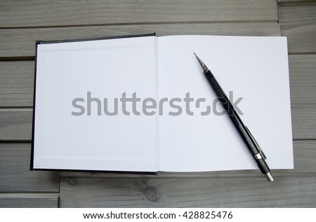 Blank Modern Book Template with pencil on wood - stock photo
