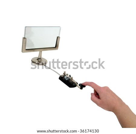 Blank monitor ready for text with antique telegraph key used as a communication device - path included - stock photo