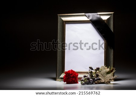 blank mourning frame on dark background - stock photo