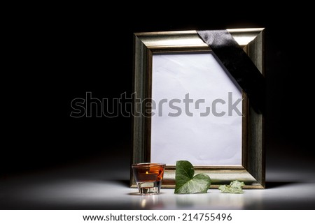 blank mourning frame with leaf and candle light - stock photo