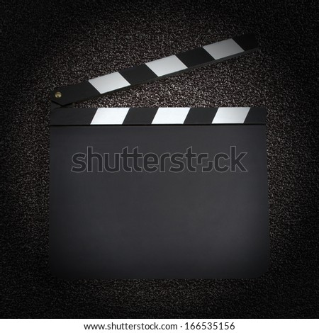 Blank movie production clapper board with copy space - stock photo