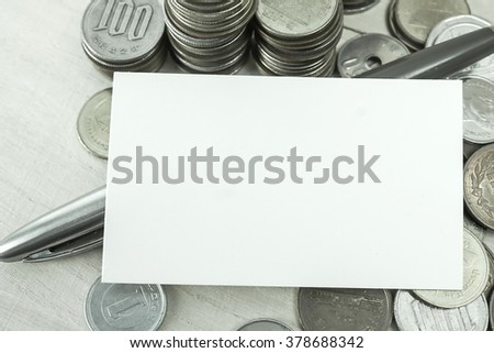 blank name card and rows of coins for finance and banking concept
