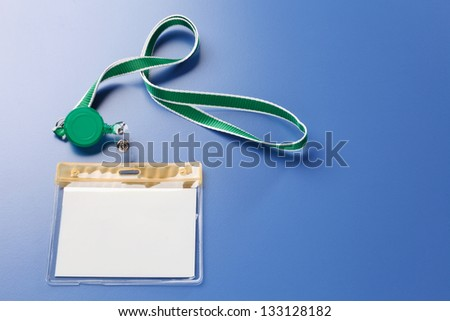 Blank name tag on the blue background - stock photo