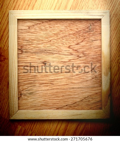 Blank new square wooden frame as background - stock photo