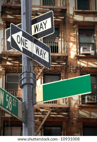 Blank New York street sign in front of apartment buildings - stock photo