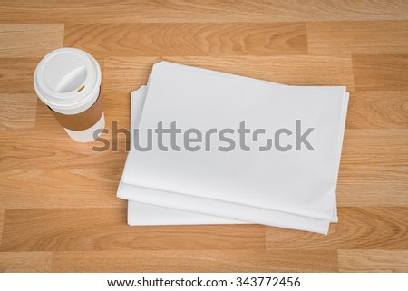 Blank Newspaper with empty space and coffee cup mock up on wood background - stock photo