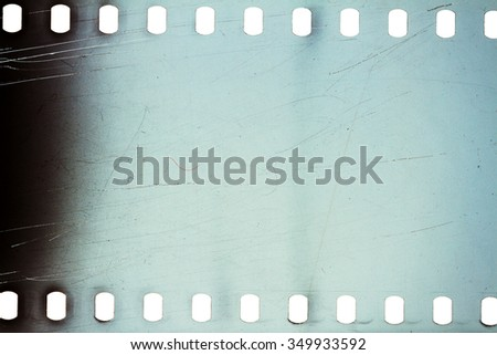 Blank noisy scratched film strip texture background