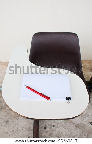 blank note and the pencil on the desk - stock photo