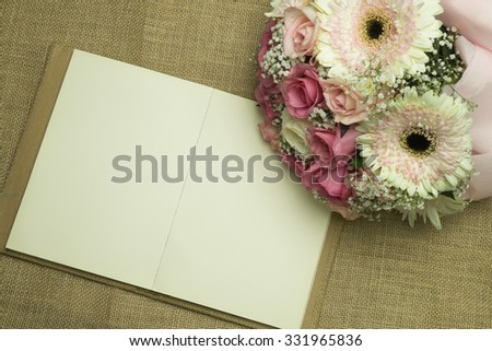 blank note on fabric and flower