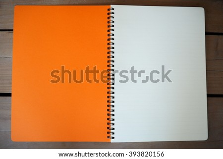 blank note paper on wood background.
