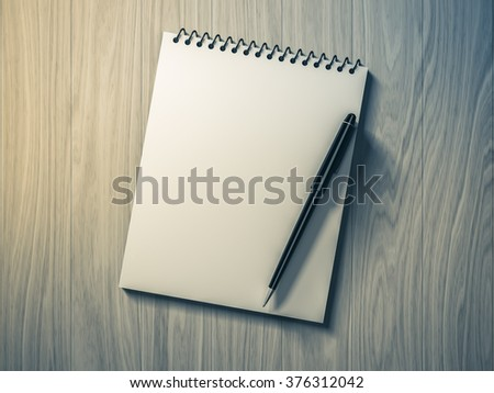Blank note paper with pen. on wood background, business object. - stock photo