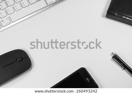 blank notebook and keyboard in the office - stock photo
