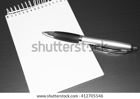 Blank notebook and pen. - stock photo