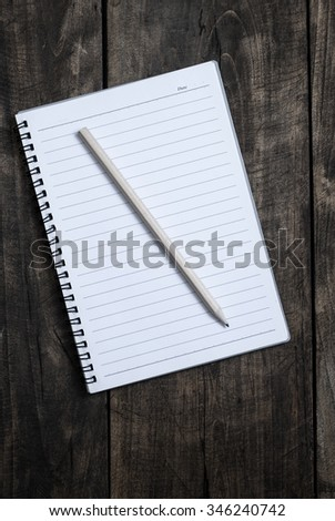blank notebook and pen  on wooden table, from above - stock photo