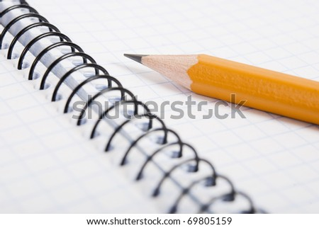 Blank notebook and pencil - stock photo