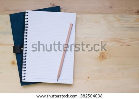 blank notebook on desk background. - stock photo