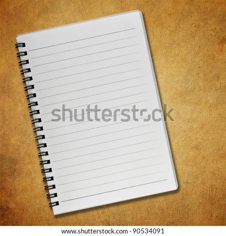 Blank notebook on old paper background - stock photo