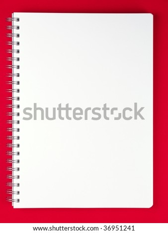Blank notebook on red table.