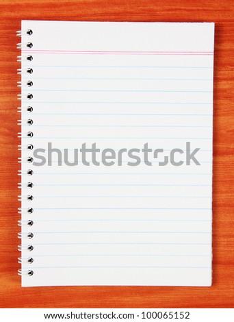 Blank notebook on wood background - stock photo