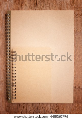 Blank notebook on wood background