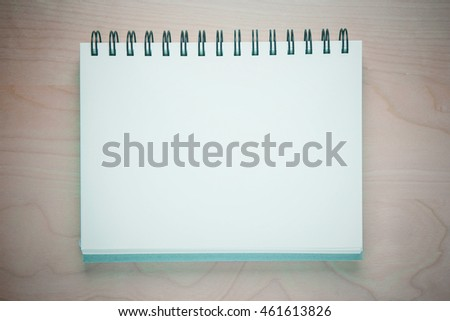 Blank notebook on wooden table. vintage color