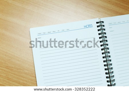 Blank notebook page on wooden background - stock photo