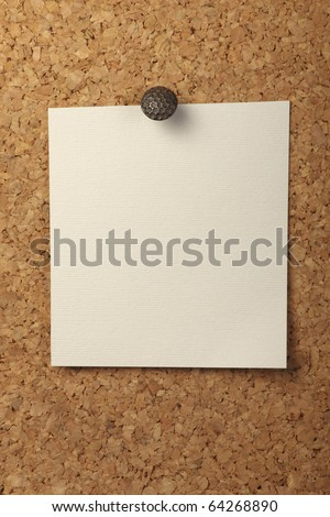 Blank notebook paper Pinned to the cork board. - stock photo