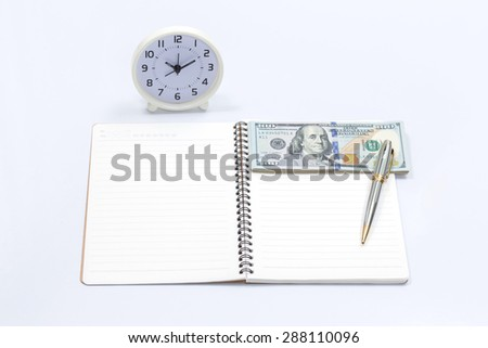 Blank notebook with clock and dollar bill for money and time concept - stock photo