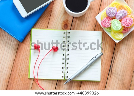 Blank notebook with pen and smart phone, coffee cup texture background for your design, business concept - stock photo