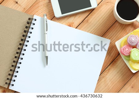 Blank notebook with pen, smart phone and coffee cup texture background for your design, business concept - stock photo