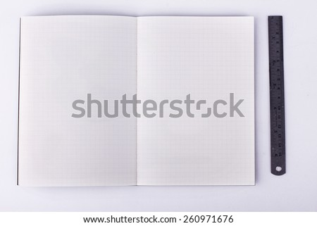 blank notebook with ruler on white background, business concept