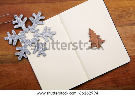 Blank Notebook With Snowflake And Cristmas Tree On Wooden Background - stock photo