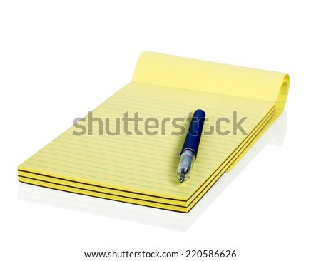 Blank notepad and pen - stock photo