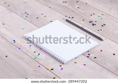 Blank notepad and pencil on the wooden table. View from above - stock photo