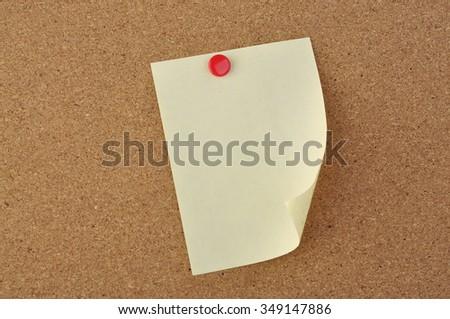 Blank Notepad on Cork Wood Notice Board - stock photo