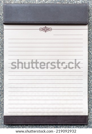Blank notepad on the brown clipboard, for memorandum in meeting room. - stock photo