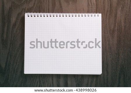 blank notepad on wood table