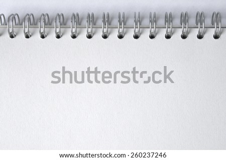Blank notepad, ring-bound, spiral notebook, horizontal, section of high quality sketch block - stock photo