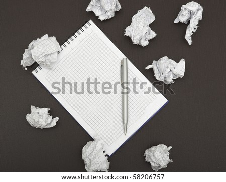 Blank notepad with ink pen on wooden desk. - stock photo