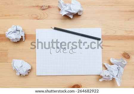 Blank notepad with pencil on wooden desk - stock photo