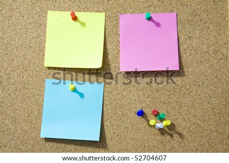 Blank notes pinned on corkboard ready for your text. - stock photo