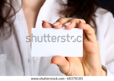 Blank of business card in woman hand - stock photo