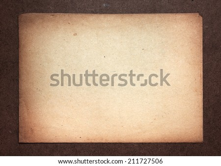 Blank old paper on old wooden desk.  - stock photo
