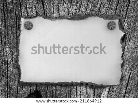 Blank old paper on wooden background - stock photo